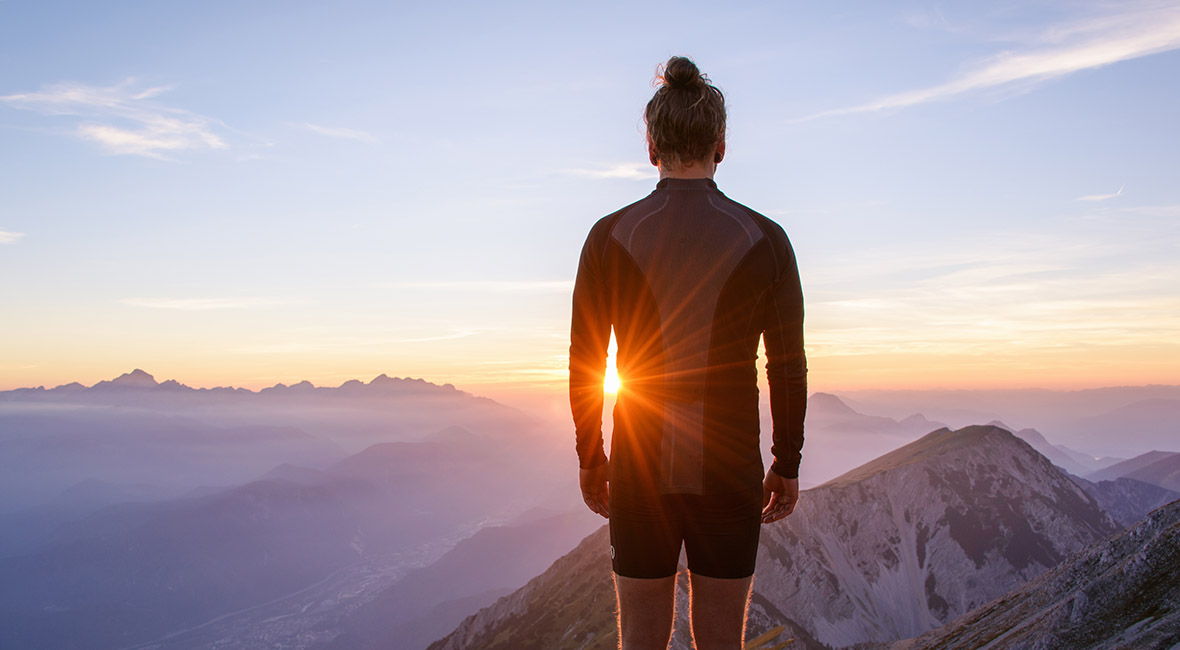 Male hiker observing the sunset