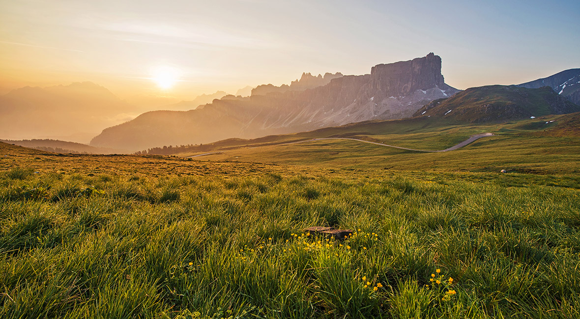 Mountain Panorama of the Dolomites as viewed from passo di Giau (as viewed from the mountain pass Giau). Photograph was taken just after the sunrise from the top of the pass.